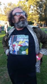 """Comedian Steven Alan Green, sporting his new """"Open Mic -Killing"""" tee shirt by artist Jim Christiansen, at the September 14th, 34th Annual San Francisco Comedy Day."""
